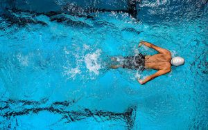 Top view of a swimmer inside the pool | The Power of Sports